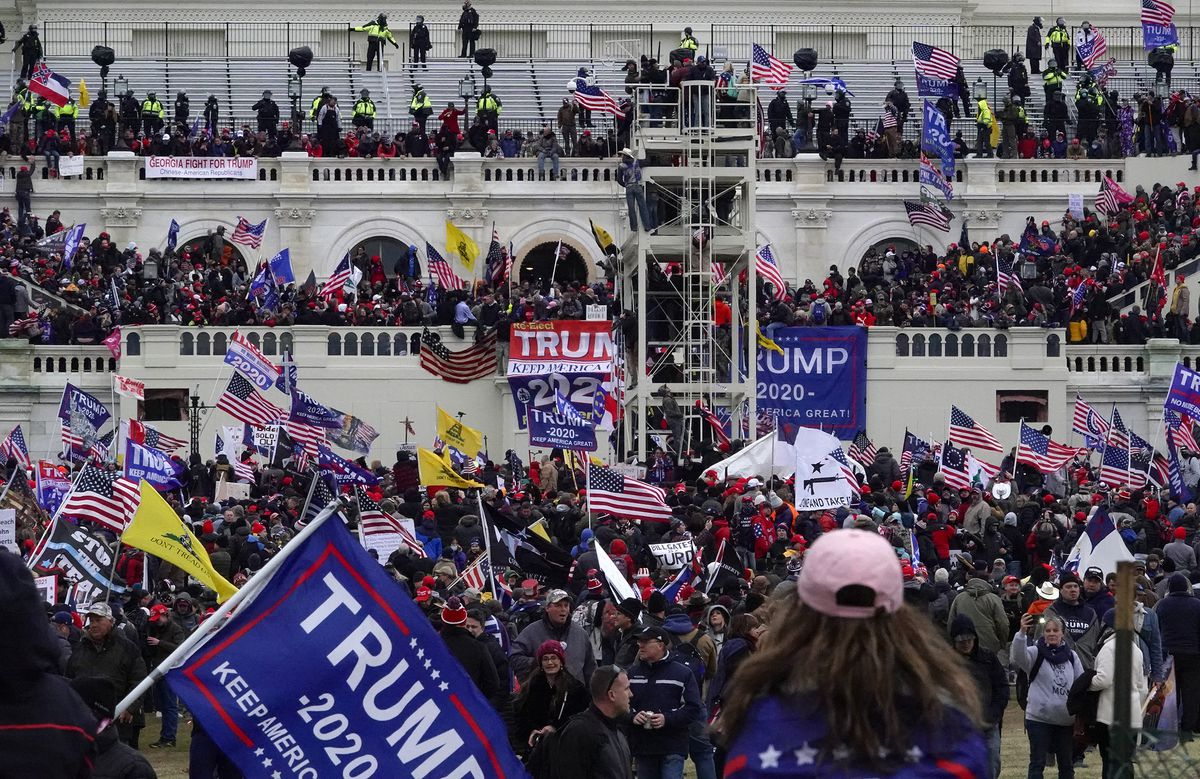 The scene Jan. 6 outside the Capitol after a mob of Trump supporters breached the building in a violent riot. (Washington Post photo by Bonnie Jo Mount)