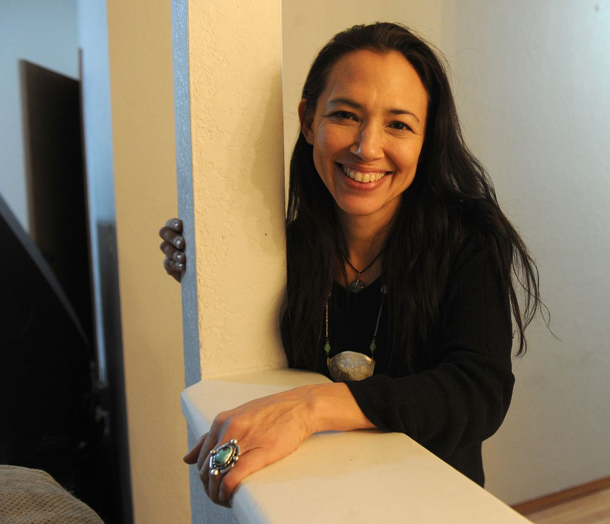 "Irene Bedard poses with Martin the black cat in south Anchorage on Wednesday, February 18, 2015. The Alaska Native actress and producer, from Anchorage, plans to bring a film version of ""Two Old Women"" by Velma Wallis to theaters. (Bob Hallinen / Alaska Dispatch News)"