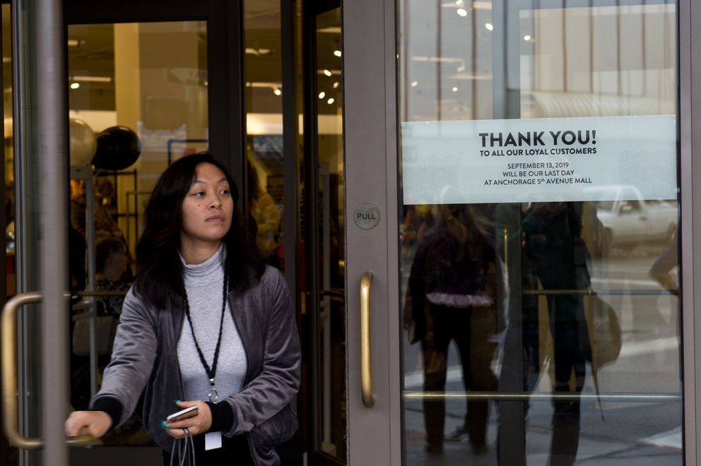 A woman exits the Nordstrom main entrance after 5 p.m., when the store closed for good. (Marc Lester / ADN)