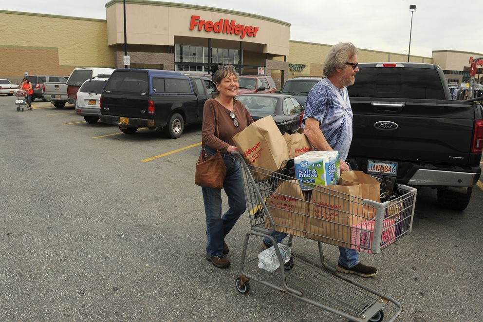 Diana and Paul Pasta wheel their paper bag filled cart to their truck at the Wasilla, AK Fred Meyer on Friday, July 13, 2018. The couple, from Talkeetna, is in favor of the plastic bag ban. (Bob Hallinen / ADN)