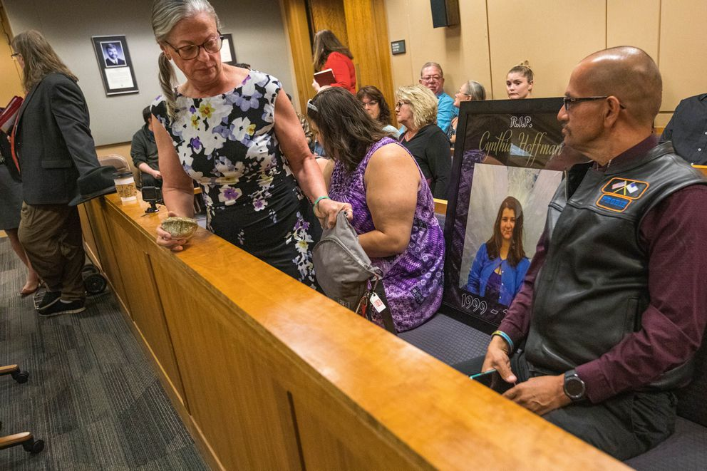 Timothy Hoffman sits next to a picture of his daughter Cynthia Hoffman, during Darin Schilmiller's arraignment Friday, Aug. 9, 2019 at the Nesbett Courthouse in Anchorage. Schilmiller has been charged with murder in relation to Hoffman's June death. (Loren Holmes / ADN)