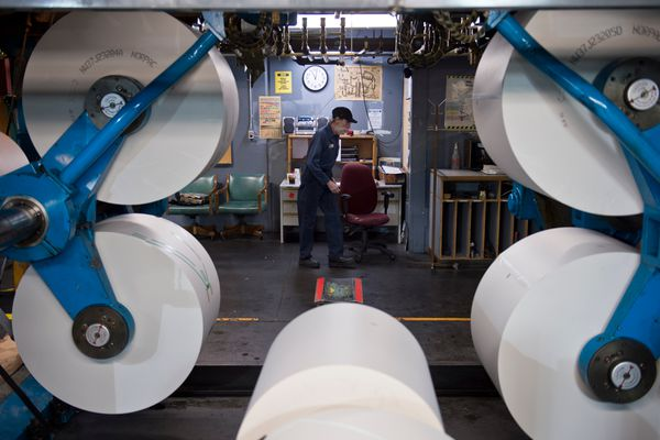 Mike Green works with the paper rolls. Pressmen, inserters and other staff produced the print edition of the Alaska Dispatch News for the last time at the press facility on Northway Drive late Oct. 14 and early Oct. 15, 2017. The press had been the production center for the Anchorage Daily News, and in recent years Alaska Dispatch News, since the 1980s. (Marc Lester / Alaska Dispatch News)