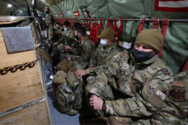 Guardsmen are seated on a KC-135 Stratotanker from the Alaska Air National Guard's 168th Wing as they prepare to depart from Joint Base Elmendorf-Richardson on Sunday, Jan. 17, 2021, to assist with Wednesday's inauguration of President-elect Joe Biden in Washington, D.C. (Bill Roth / ADN)