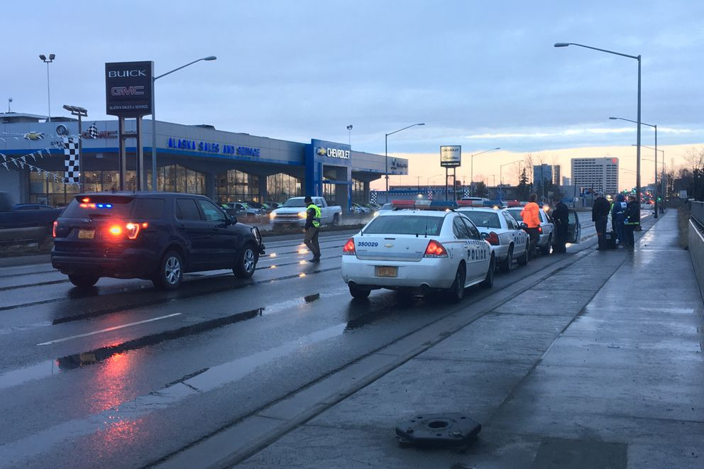 Anchorage police officers investigate a crash on Fifth Avenue near Concrete Street that sent a pedestrian to the hospital with serious injuries on Wednesday, April 17, 2019. (Madeline McGee / ADN.)