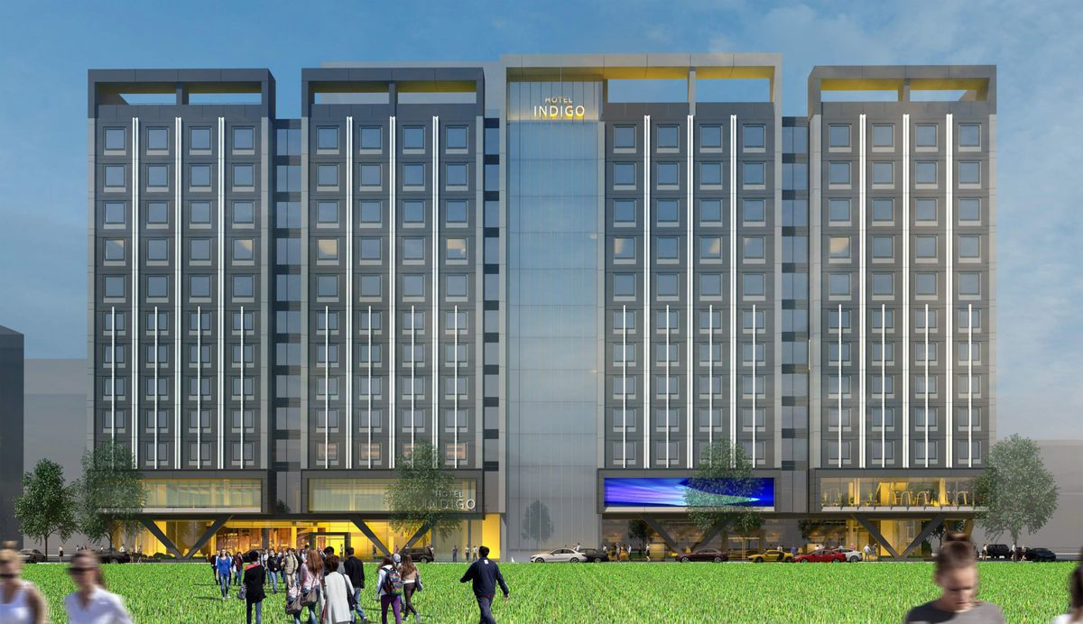 An artist's rendering of the proposed Hotel Indigo at 700 W.6th Ave. It is currently the site of the People Mover Downtown Transit Center. The grass in the rendering does not exist and is not planned at the space, currently a parking lot. (2020 Artist rendering by RIM Architects)