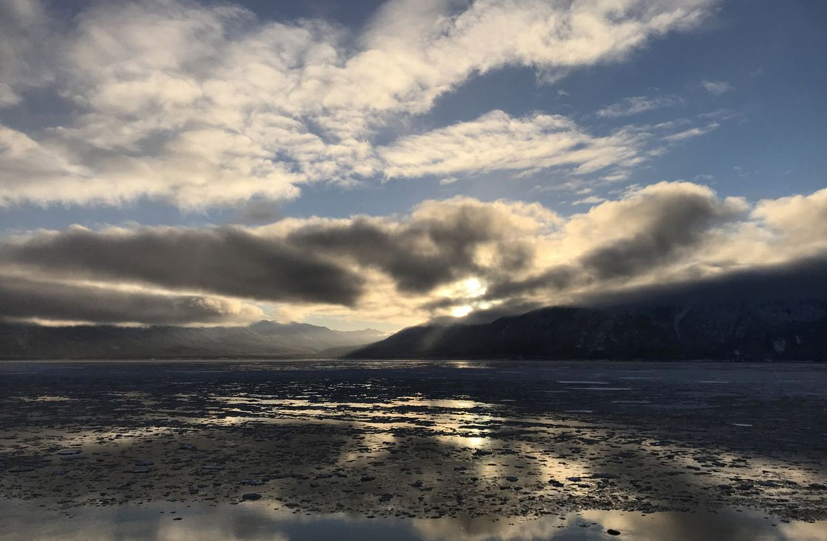 Sunlight reflects off an ice-filled Turnagain Arm on Thursday, Dec. 20, 2018. (Bill Roth / ADN)
