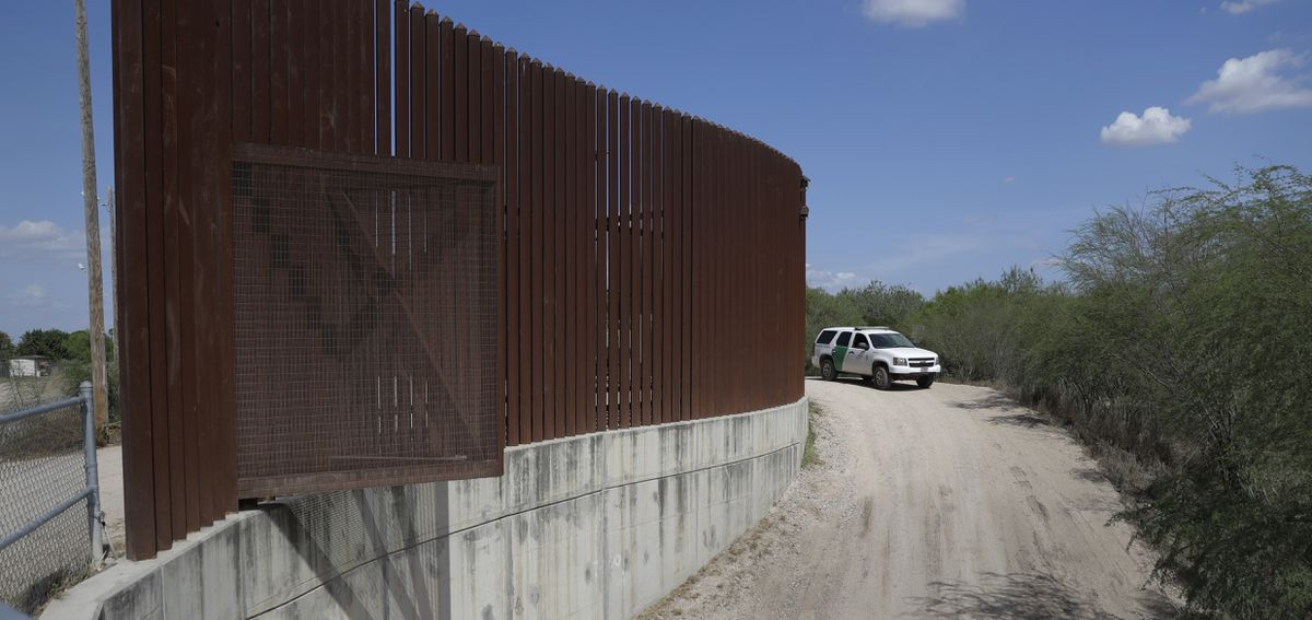 A U.S. Customs and Border Patrol vehicle passes along a section of border levee wall in Hidalgo, Texas, in 2017. (AP Photo/Eric Gay, File)