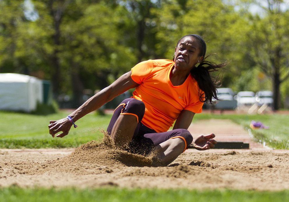 Janay DeLoach lands in the long jump pit during a 2015 practice session at the Colorado State University track and field complex in Ft. Collins. DeLoach competed for Colorado State and lives in Fort Collins. (Michael Bettis / for The Coloradoan)