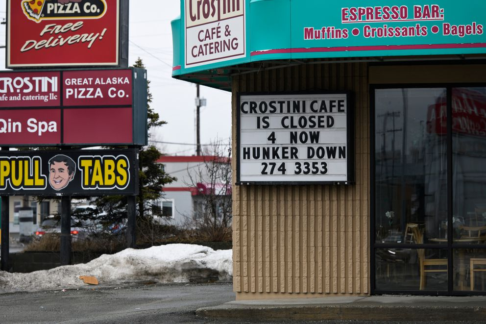 A sign on Crostini Cafe encourages people to hunker down on April 16, 2020. (Marc Lester / ADN)