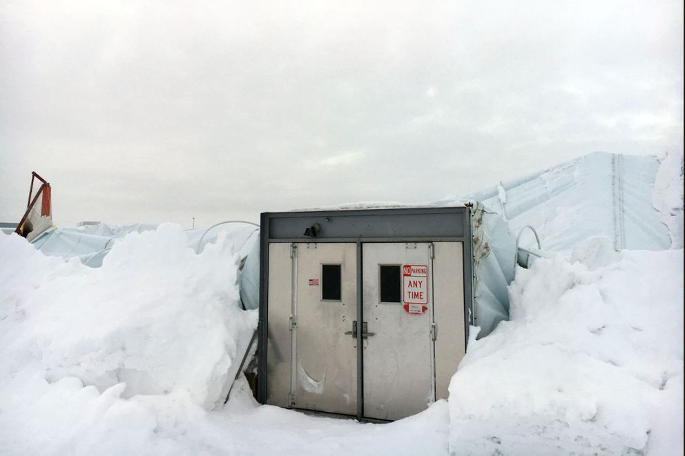 A door survives Saturday night's collapse of air-supported Dome.  (David Hulen / Alaska Dispatch News)