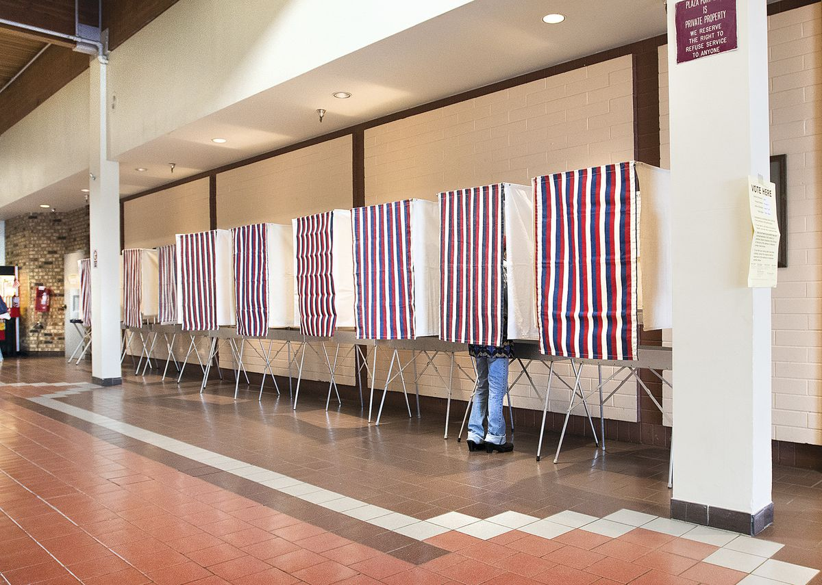 In this Aug. 21, 2018 file photo, a voter uses a polling booth during primary election day at Ketchikan Precinct 2 in the Plaza building in Ketchikan (Dustin Safranek /Ketchikan Daily News via AP, File)