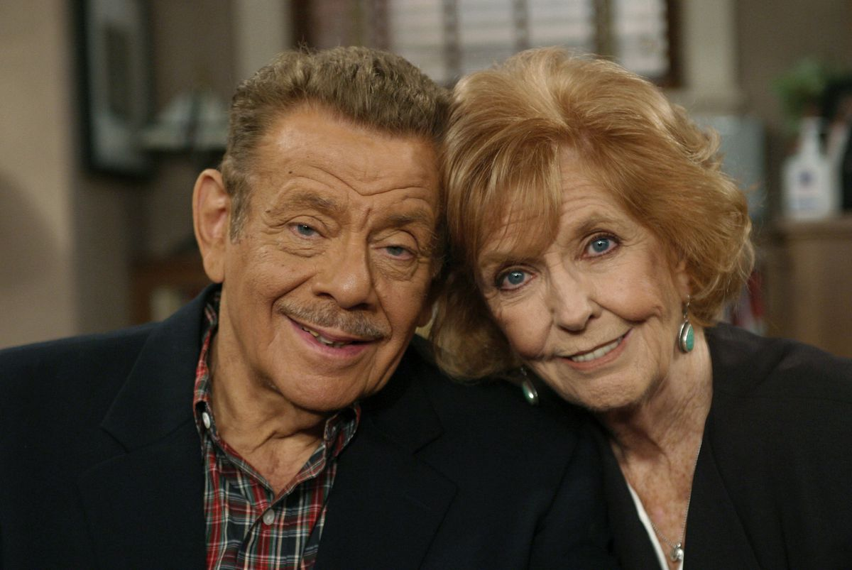 FILE- In this Nov. 6, 2003, file photo, Jerry Stiller, left, and his wife Anne Meara pose on the set of