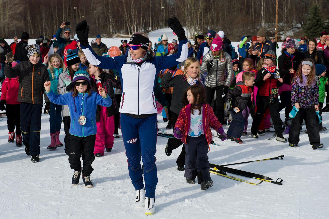 Kikkan Randall leads a crowd of kids in activities at the Ski With Alaska's Olympians event at Kincaid Park on April 6. (Marc Lester / ADN)