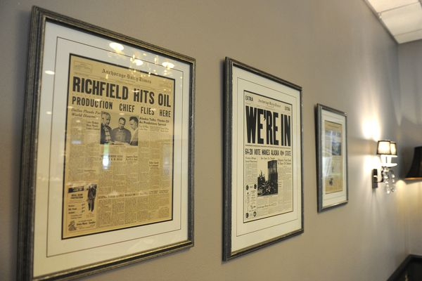 Anchorage Daily Times front pages featuring the discovery of oil at Prudhoe Bay, the entry of Alaska as a the 49th state and the beginning of work on the trans-Alaska Pipeline in the dining room of the Petroleum Club. (Bob Hallinen / Alaska Dispatch News)