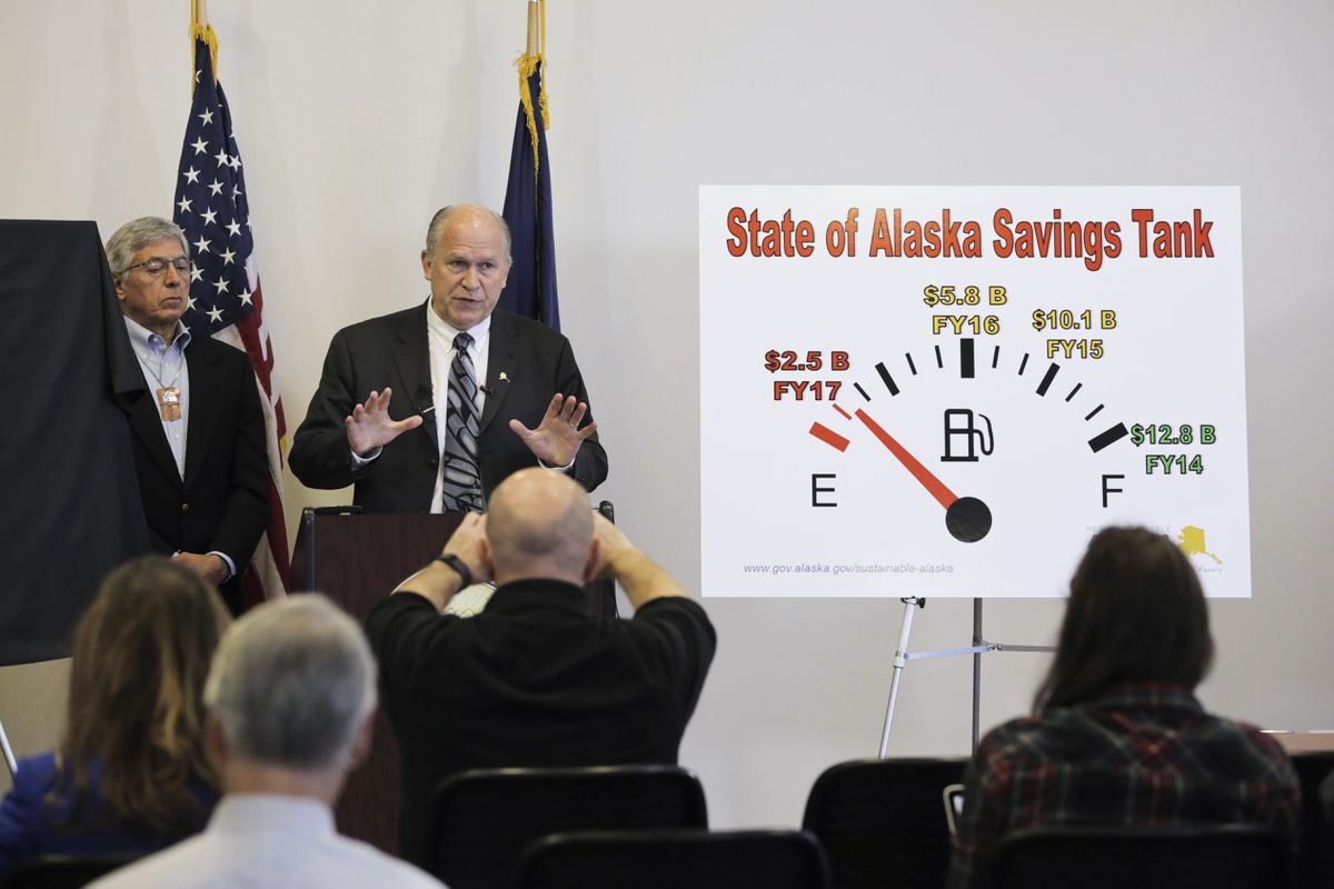 Gov. Bill Walker, right, and Lt. Gov. Byron Mallott discuss Alaska's budget situation at a press conference in Anchorage on Wednesday, June 29, 2016. (Loren Holmes / Alaska Dispatch News)