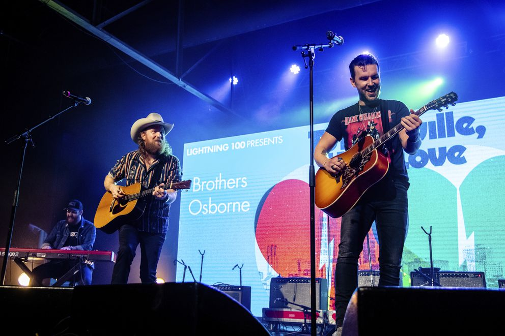 John Osborne, left, and T.J. Osborne of Brothers Osborne perform at the To Nashville, With Love Benefit Concert at Marathon Music Works on Monday, March 9, 2020, in Nashville, TN. (Photo by Amy Harris/Invision/AP)