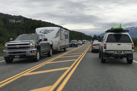 Northbound traffic Seward Highway, left, passes by slow moving Southbound traffic at Potter Marsh after a minor traffic collision on Sunday. (Bill Roth / ADN)