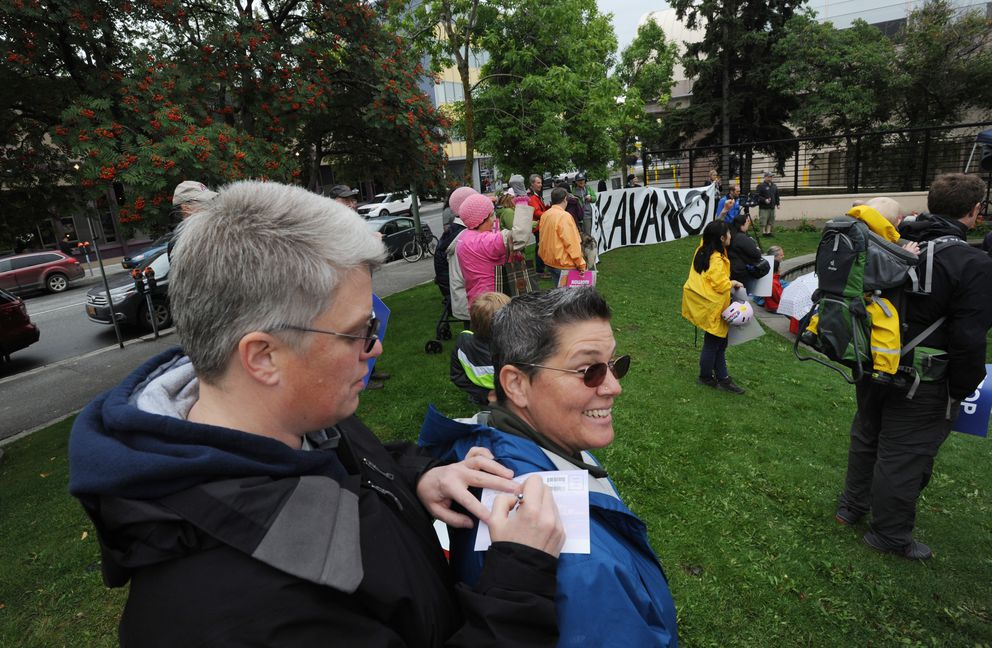 Carolyn Ramsey writes a postcard to Sen. Lisa Murkowski asking her to vote no on Pres. Donald Trump's Supreme Court nominee Brett Kavanaugh during a rally at Peratrovich Park in downtown Anchorage on Women's Equality Day, Sunday, August 26, 2018. Paige Coatney, right, also filled out a post card and they both said they sent letters via email encouraging Sen. Murkowski to vote no. (Bill Roth / ADN)