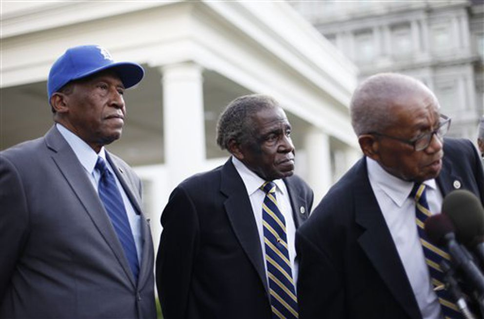 Former baseball players in the Negro League, from left to right, Pedro Sierra, Minnie Minoso, and Ron Teasley, talk outside the West Wing of the White House in Washington following their meeting with President Barack Obama, Monday, Aug. 5, 2013. They competed for teams like the Philadelphia Stars, New York Black Yankees, Indianapolis Clowns and Boston Blues. (AP Photo/Pablo Martinez Monsivais)