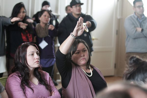 Kawerak CEO and President Melanie Bahnke raises her hand to be heard, while audience members point towards her, during the AFP-sponsored Governor's roadshow in Nome, Alaska, March 27, 2019. (Photo by Diana Haecker / The Nome Nugget)
