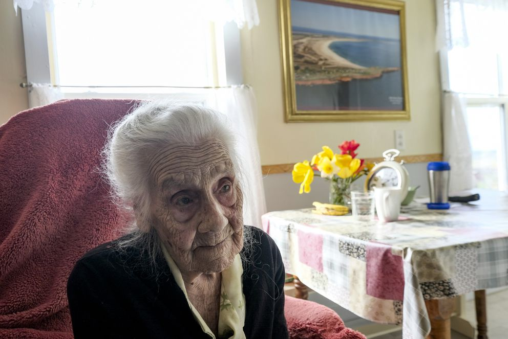 Rhoda Davies, 101, has lived almost all her life in the same hilltop house in Old Harry, constructed with wood from a shipwreck. Davies said winters on the islands now have far less ice and snow than those of her youth. 'It must be climate change, wouldn't you say? ' she said. (Washington Post photo by Bonnie Jo Mount)