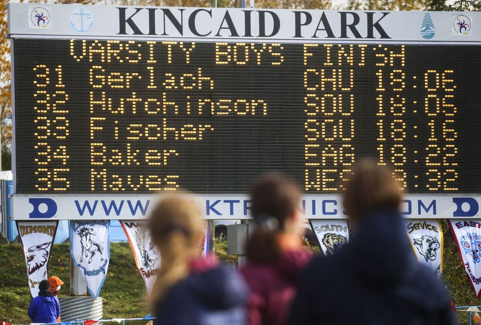 People look up to see race times on the Kincaid Park scoreboard. (Emily Mesner / ADN)