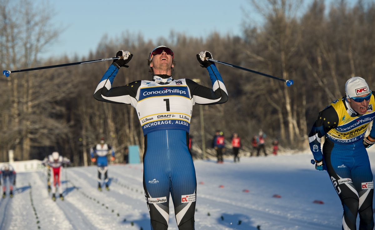 APU skier Reese Hanneman claims the classic sprint championship Monday at Kincaid Park, crossing the finish line just ahead of Tyler Kornfield, right. (Marc Lester / ADN)