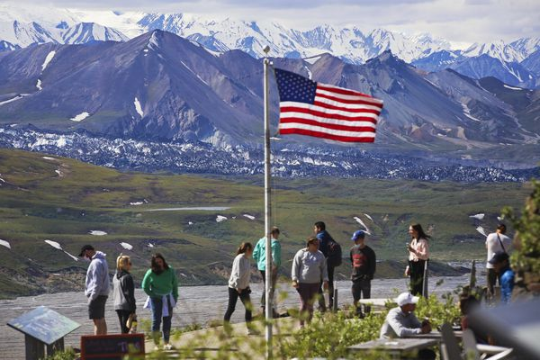 Visitors take in the view from Eielson Visitor Center in Denali National Park and Preserve on Sunday, June 20, 2021. The Muldrow Glacier's recent surge is visible just above the green tundra. (Emily Mesner / ADN)