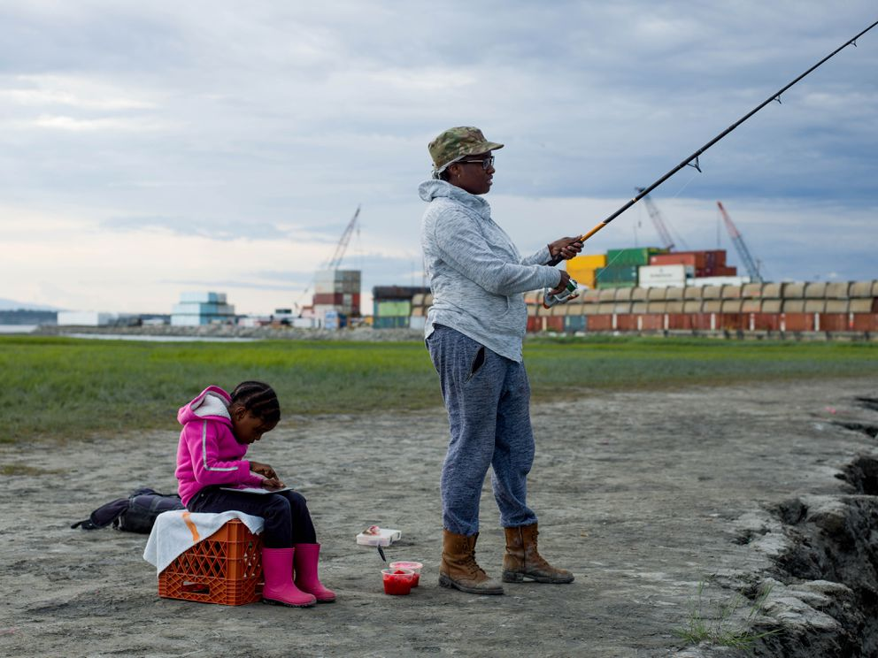 Cipriana Williams fishes at Ship Creek in Anchorage with her niece. (Ash Adams for The Washington Post)