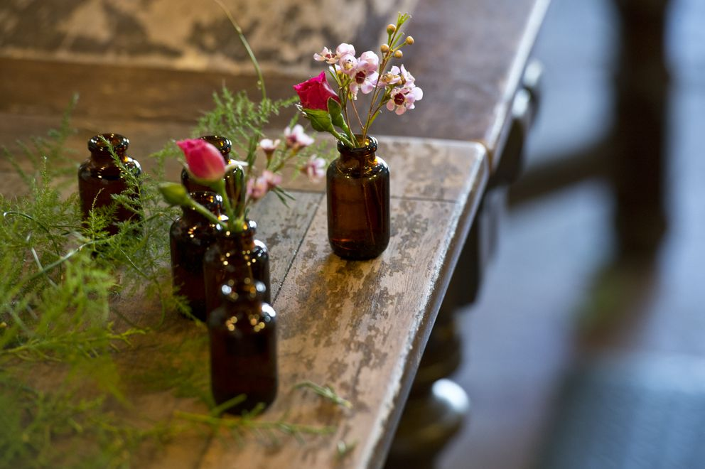 Small arrangements of waxflowers are prepared by florist Dallas Wildeve at Bloomsbury Blooms. Photographed on March 21, 2018. (Marc Lester / ADN)