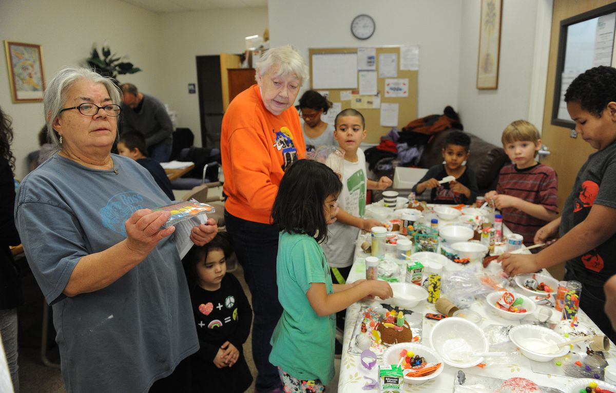 Cris Tyree, left, and Rozann Kimpton help with Halloween cake decorating in Wasilla in mid-October. Both ladies have adopted their grandchildren. (Bob Hallinen / Alaska Dispatch News)