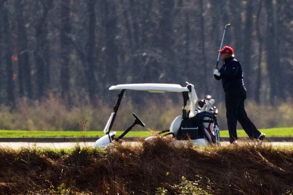 President Donald Trump plays golf at Trump National Golf Club in Sterling, Va., as seen from the other side of the Potomac River in Darnestown, Md., Saturday, Nov. 14, 2020. (AP Photo/Manuel Balce Ceneta)
