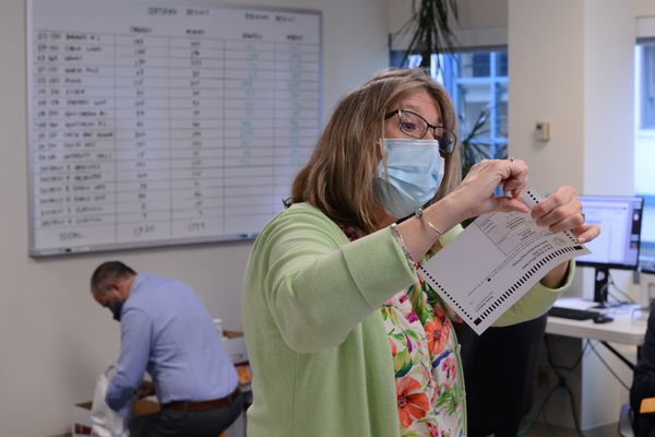 Gail Fenumiai, director of the Alaska Division of Elections, checks to see whether ink from a folded marked ballot could cause a mistaken vote. Fenumiai oversaw a recount on Wednesday, Sept. 2, 2020 in a close Republican primary race. (James Brooks / ADN)