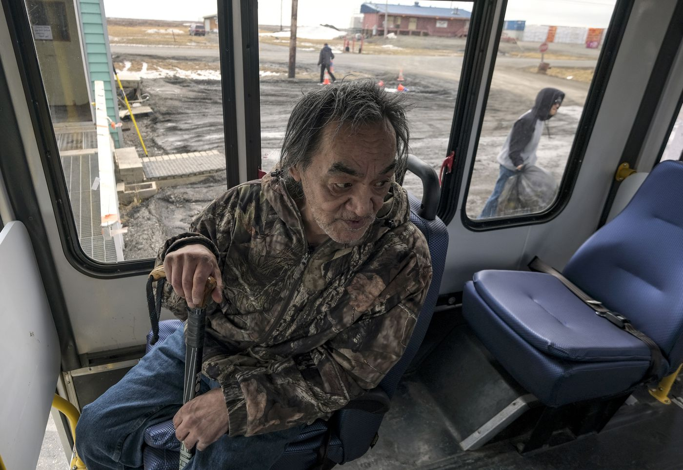 Edward Nukapigak, Martha Itta's uncle, on a seniors' shuttle. He says oil dividends and payments to the community are essential. (Washington Post photo by Bonnie Jo Mount)