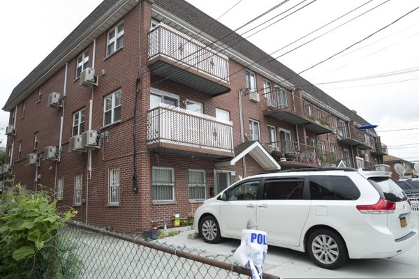 The house were five people were stabbed overnight is seen, Friday, Sept. 21, 2018, in New York. Police say the people, including three infants, were stabbed at an overnight day care center in New York City. (AP Photo/Mary Altaffer)