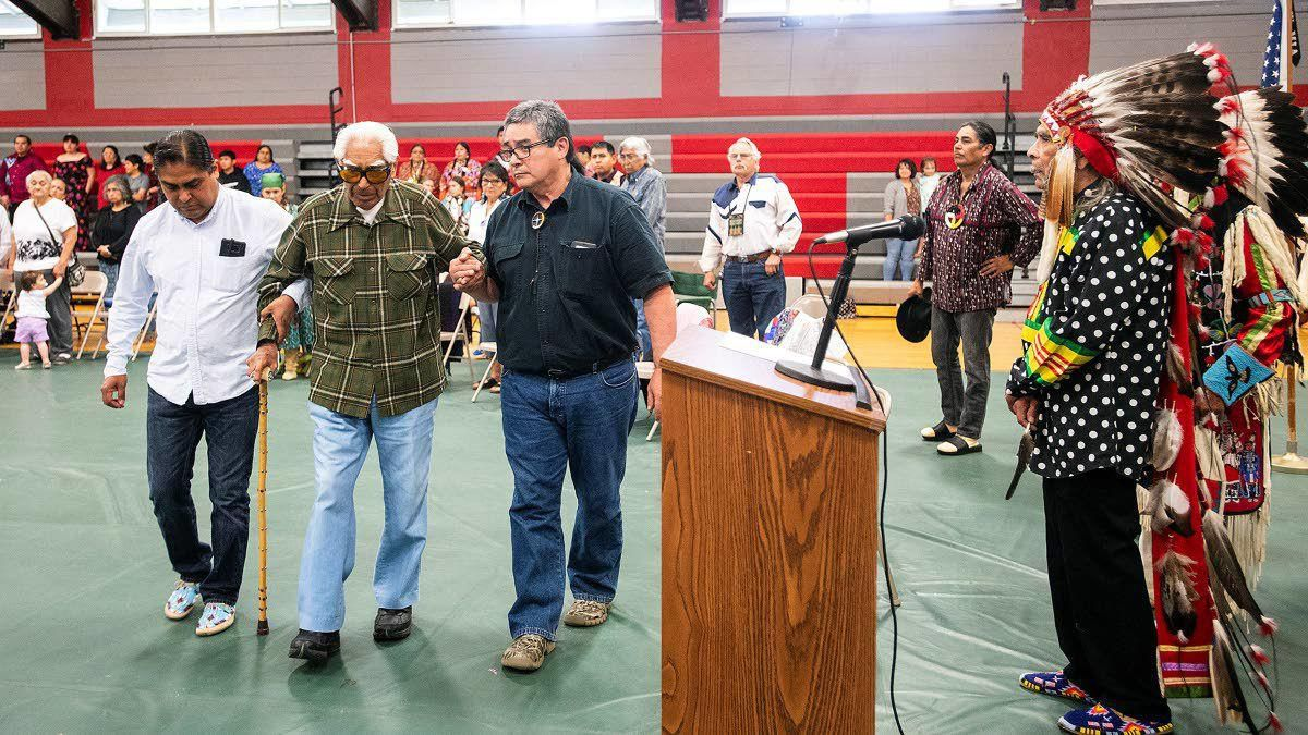With the aid of family members, Alex Pinkham Jr., 94, of Anchorage, walks as he is honored for his service in World War II during a ceremony Saturday, June 8, 2019, at the Pi-Nee-Waus Community Center in Lapwai, Idaho. (Pete Caster / The Lewiston Tribune)