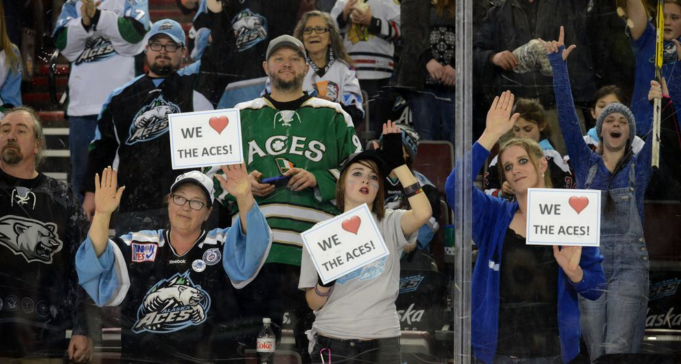 The Alaska Aces fans show their love as the Aces were called back onto the ice as fans stayed and stood after their final game in franchise history at the Sullivan Arena on Saturday.  (Bob Hallinen / Alaska Dispatch News)