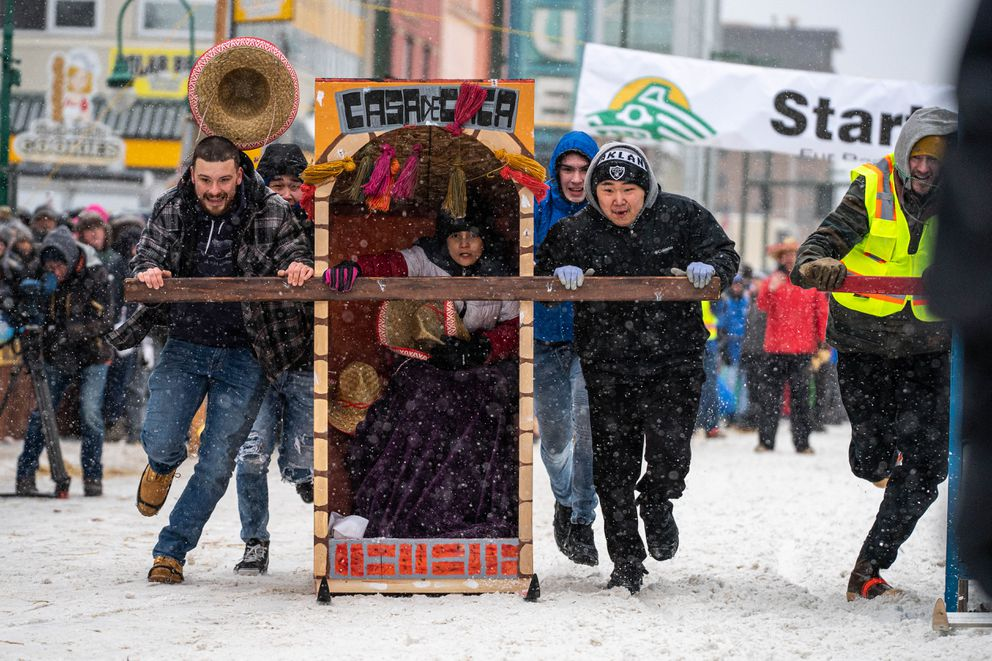 Team Casa de Caca competes in the Fur Rondezvous outhouse races on Saturday, Feb. 29, 2020 in Anchorage. (Loren Holmes / ADN)