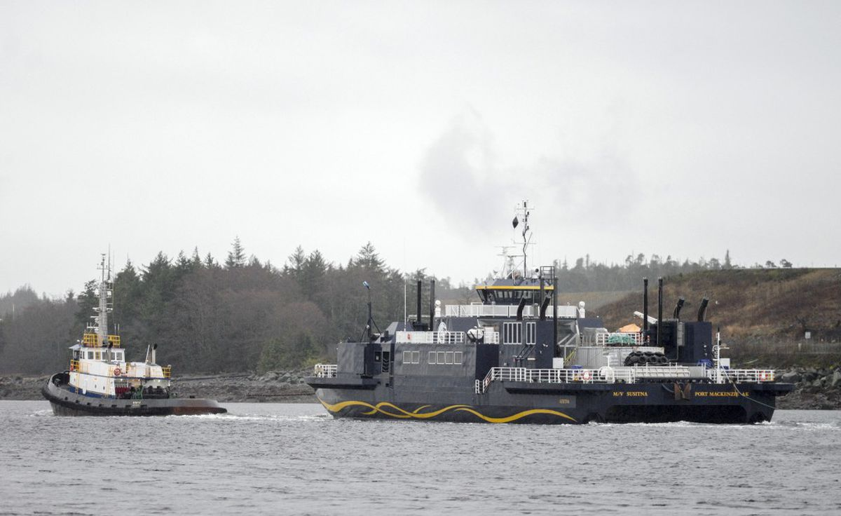 The M/V Susitna — under tow —passes in front of Gravina Island on Friday, Feb. 19, 2016. (Taylor Balkom / Ketchikan Daily News)