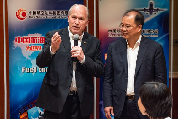 Alaska Gov. Bill Walker and Alaska trade delegates met in Beijing in May 2018 with representatives of the China National Aviation Fuel Group to discuss direct flights between China and Alaska. Walker is with Xi Zhenping, general manager of CNAF. (Photo courtesy Office of the Governor)