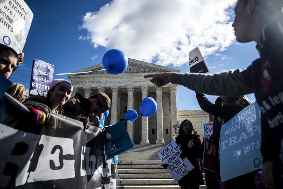 FILE — Anti-abortion and pro-abortion rights demonstrators rally outside the Supreme Court in Washington, March 2, 2016. (Gabriella Demczuk/The New York Times)