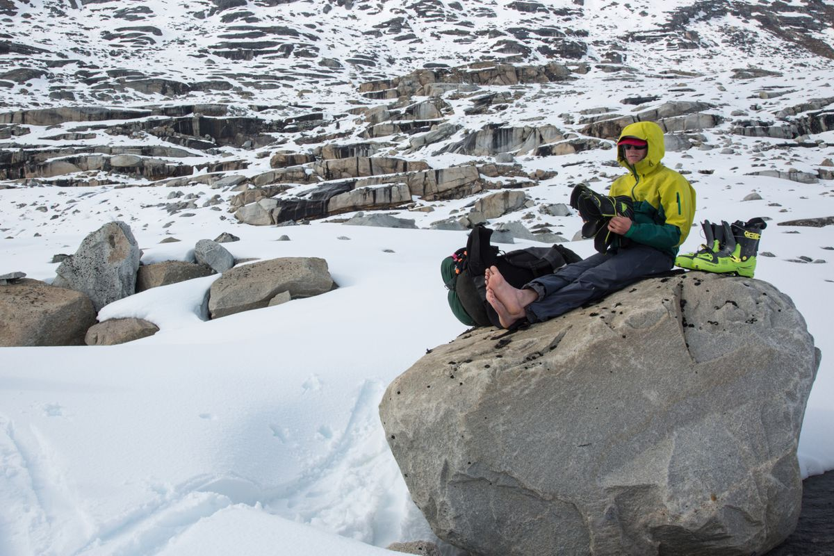Jeremy Wood takes a break for blister protection mid-way througha 100-mile, 10-day ski from Haines to Skagway, April, 2016. (Luc Mehl / thingstolucat.com)