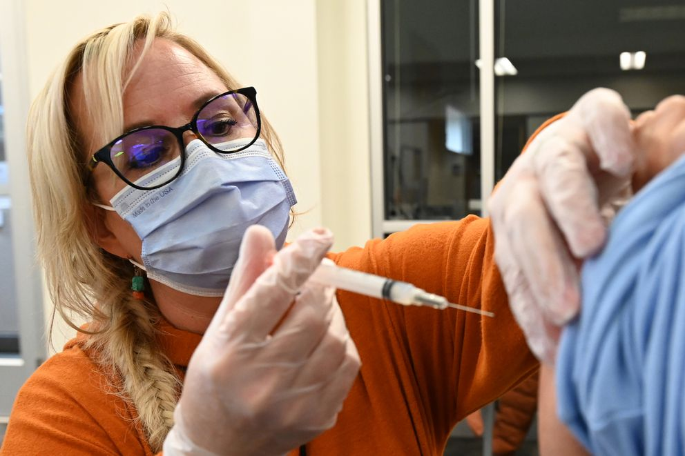 South High School nurse Susie Whited prepares to administer a Moderna COVID-19 vaccine at the ASD Education Center on Thursday, Jan. 7, 2021. (Bill Roth / ADN)