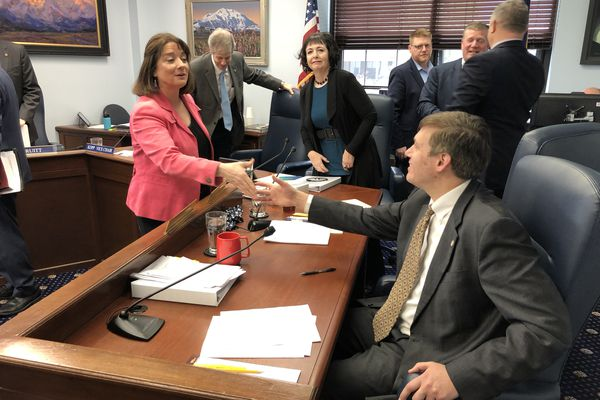 Sen. Lora Reinbold, R-Eagle River, congratulates Sen. Bill Wielechowski, D-Anchorage, following a vote approving a compromise deal to repeal and replace Senate Bill 91 on Thursday, May 16, 2019. (James Brooks / ADN)