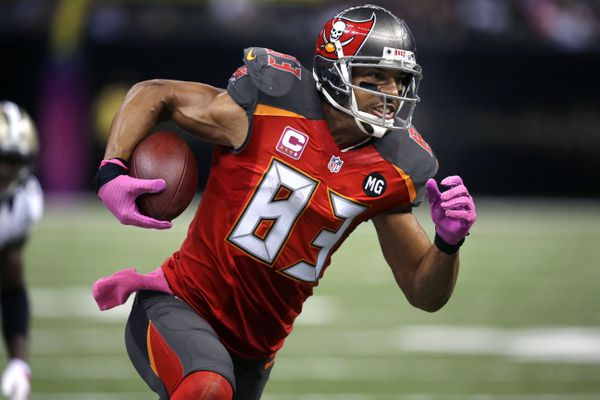 FILE - In this Oct. 5, 2014, file photo, Tampa Bay Buccaneers wide receiver Vincent Jackson (83) runs with the ball in the second half of an NFL football game against the New Orleans Saints in New Orleans. Florida authorities are looking into the death of former Buccaneers player Jackson, who was found dead Monday, Feb. 15, 2021, at a Florida hotel room. (AP Photo/Bill Haber, File)