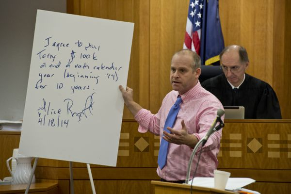 Jeffrey Robinson, lawyer for Tony Hopfinger, holds an enlarged version of a message originally written on a napkin by Alice Rogoff. A lawsuit between former Alaska Dispatch editor Tony Hopfinger and owner Alice Rogoff began on November 14, 2018. Hopfinger claims he is owed money that he said Rogoff agreed to pay on a cocktail napkin. (Marc Lester / ADN)