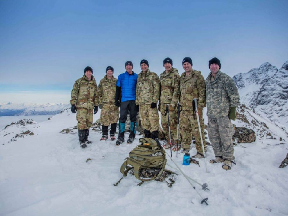 Kirk Alkire (in blue) poses with a group of soldiers atop Gold Star Peak near Eklutna Lake. (Photo courtesy of Kirk Alkire/Gold Star Peak Alaska)