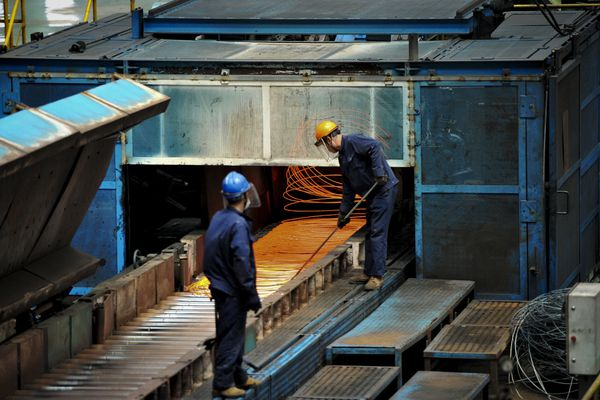 In this June 8, 2018, photo, a worker handles red hot steel cables at a steel factory in Qingdao in east China's Shandong province. The Trump administration on Monday, July 16, 2018, brought cases against China, the European Union, Canada, Mexico and Turkey at the World Trade Organization for retaliating against American tariffs on imported steel and aluminum. (Chinatopix via AP)