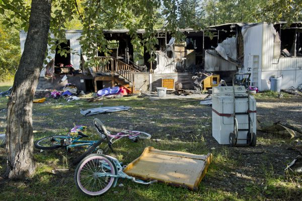 A trailer home at 2910 S. Wickham Circle in Butte is in ruins on September 8, 2017. a day after it was destroyed by a fire. Five children died in the fire. (Marc Lester / Alaska Dispatch News)