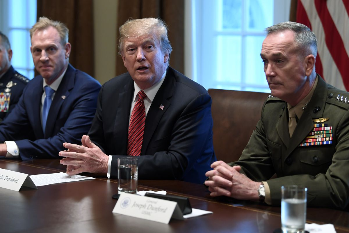 President Donald Trump, center, flanked by acting Defense Secretary Patrick Shanahan, left, and Chairman of the Joint Chiefs of Staff Gen. Joseph Dunford, right, speaks during a meeting with military leaders at the White House in Washington, Wednesday, April 3, 2019. (AP Photo/Susan Walsh)
